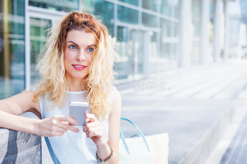woman using app on her phone royalty free stock photos