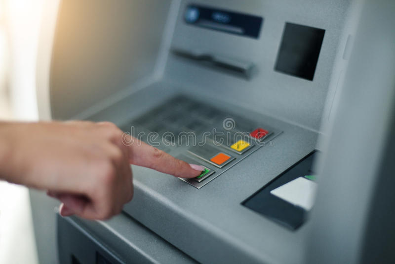 Woman using banking machine. Close up royalty free stock photography