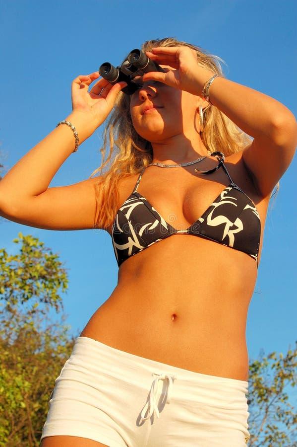 Download Woman Using Binoculars Royalty Free Stock Photography - Image: 3214557