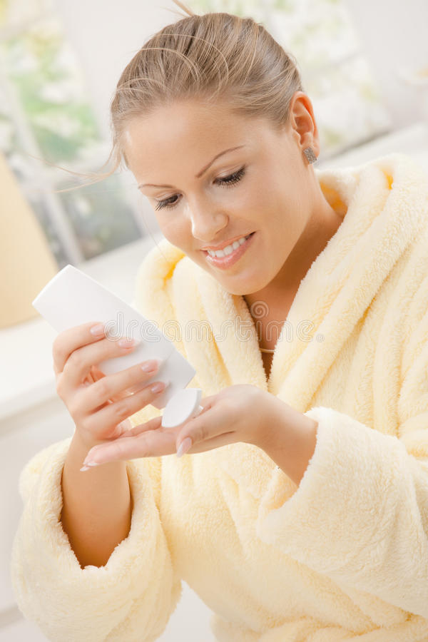Download Woman using body lotion stock photo. Image of expression - 12518564