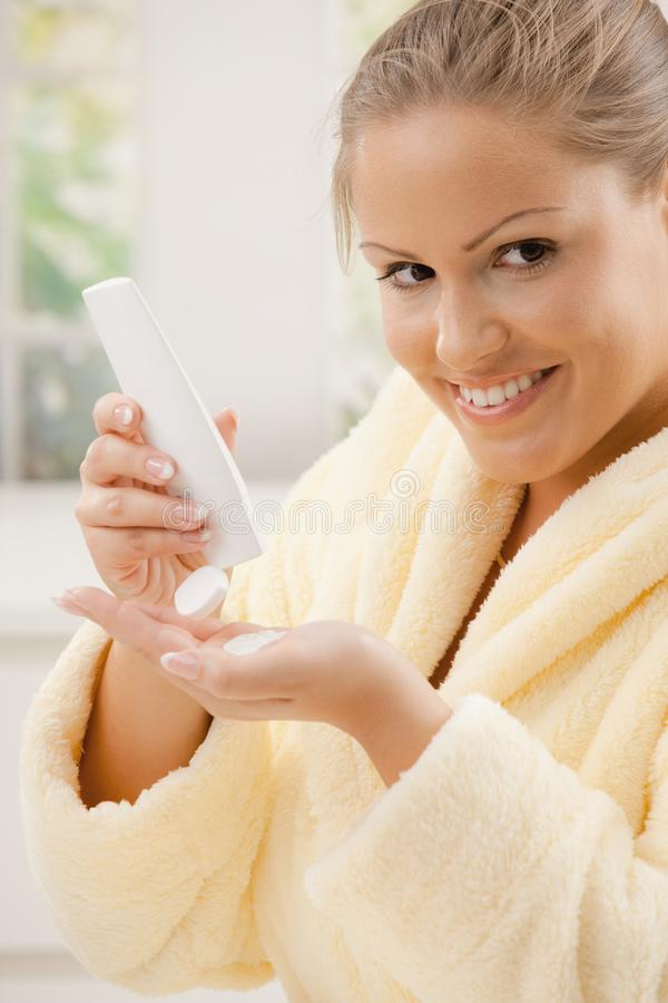 Download Woman using body lotion stock photo. Image of adult, feminine - 18216084