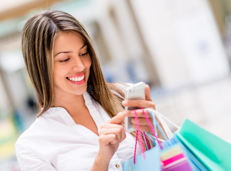 Download Woman Using Cell Phone While Shopping Stock Image - Image: 31578025