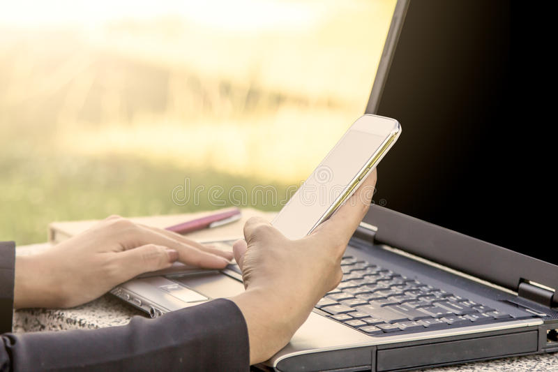 Woman using cellphone,smart phone,phone with laptop stock images