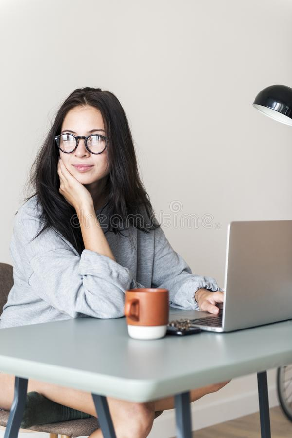 Woman using computer laptop in her room stock photos