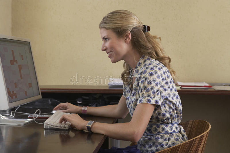 Woman Using Computer In Office stock image