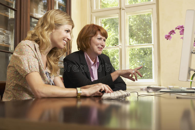 Download Woman Using Computer In Study Room Stock Photography - Image: 33893172