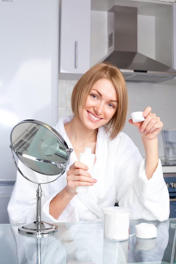 Woman using cosmetics stock photos