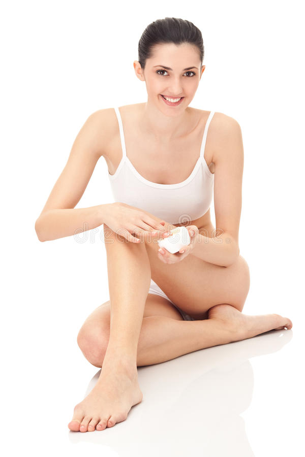 Woman using cream stock photography