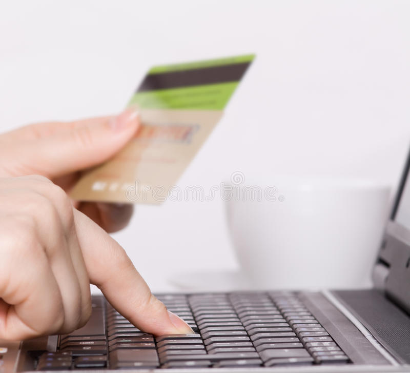 Download Woman using a credit card stock image. Image of card - 22688115
