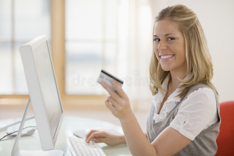 Download Woman Using Credit Card And Computer Stock Photo - Image: 6536002
