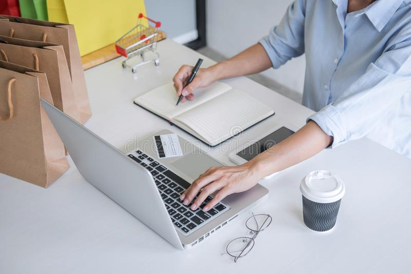 Woman using credit card register security code and payments online shopping and customer service network connection market, using. On laptop, Internet Online royalty free stock photography