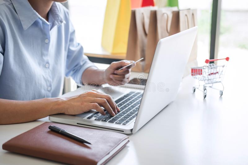 Woman using credit card register security code payments online shopping and customer service network connection market, using. Technology on laptop, Internet royalty free stock images
