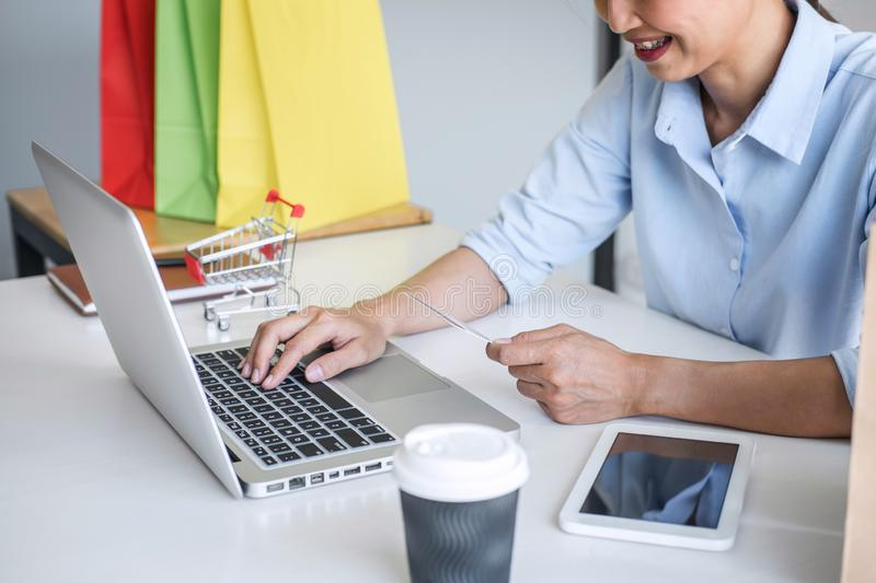 Woman using credit card register security code and payments online shopping and customer service network connection market, using. On laptop, Internet Online royalty free stock photo