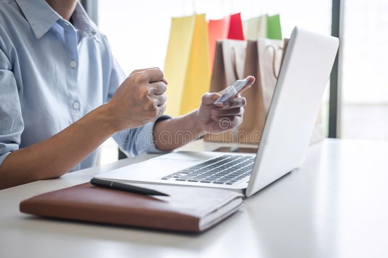 Woman using credit card register security code payments online shopping and customer service network connection market, using. Technology on laptop, Internet royalty free stock photo