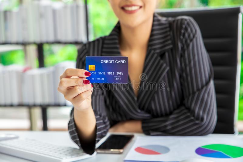 Woman using credit card to pay the bill. Technology online shopping royalty free stock image