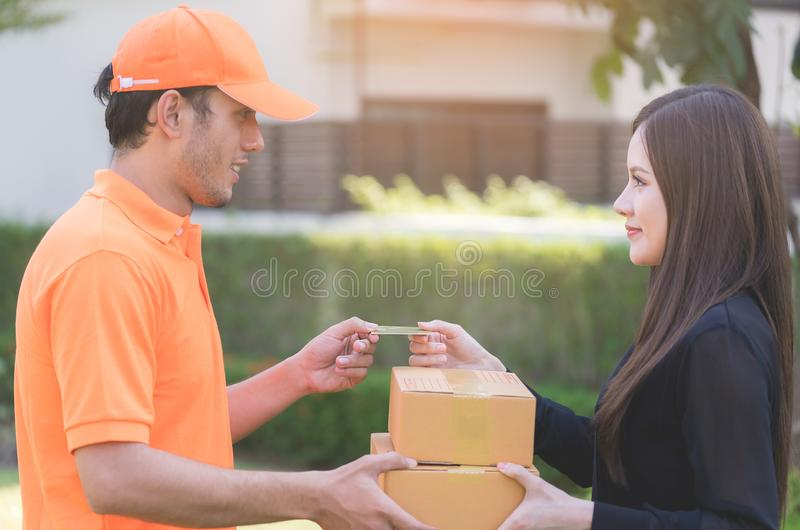 Woman using credit card to pay for online delivery stock photo