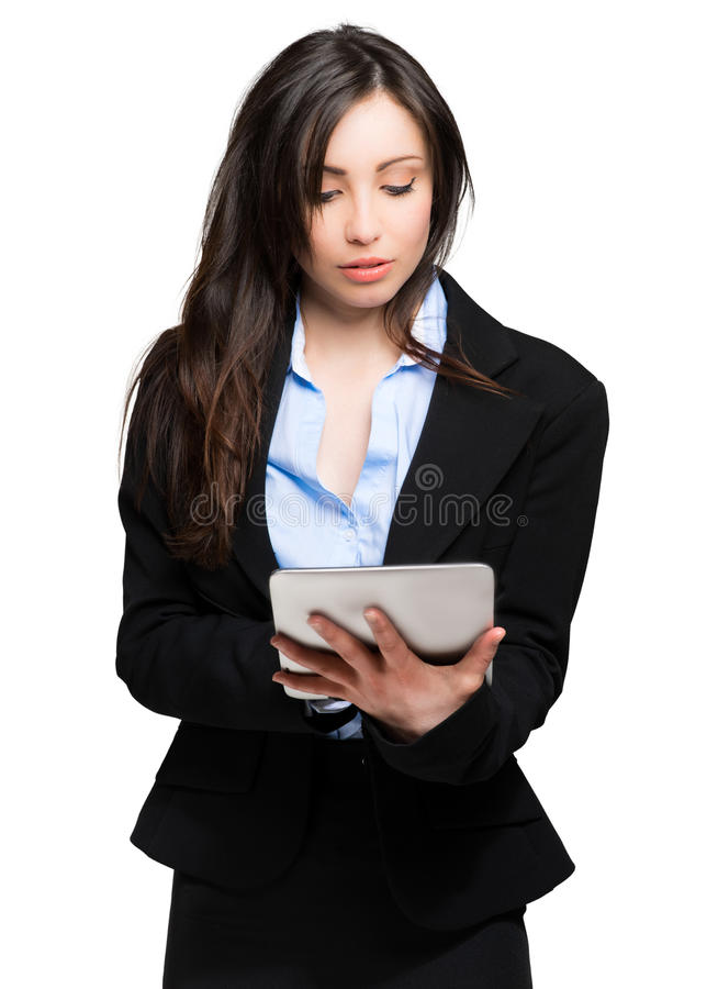 Woman using a digital tablet, isolated on a white background royalty free stock photo