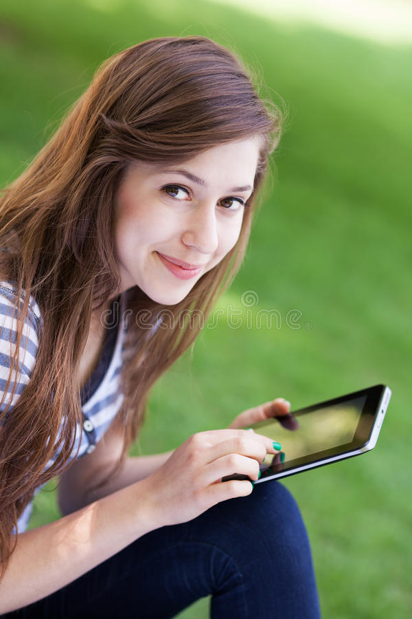 Download Woman Using Digital Tablet Outdoors Stock Image - Image: 25293559