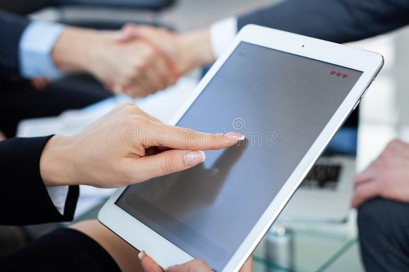 Woman using digital tablet on workplace close up. stock photos