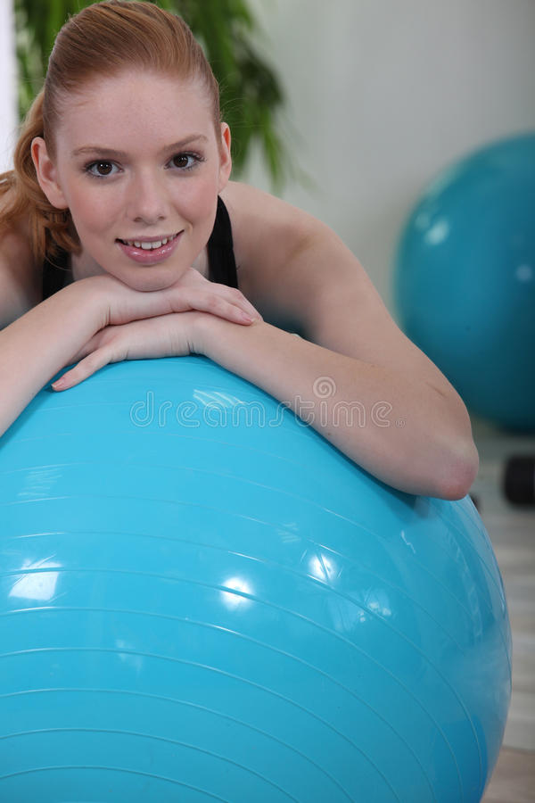 Woman using an exercise ball stock photography