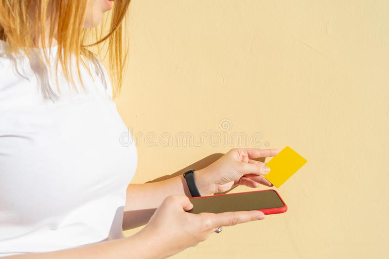 Woman using finger print signature system to make secure verification on her smart phone with her credit card and pay with online royalty free stock photography