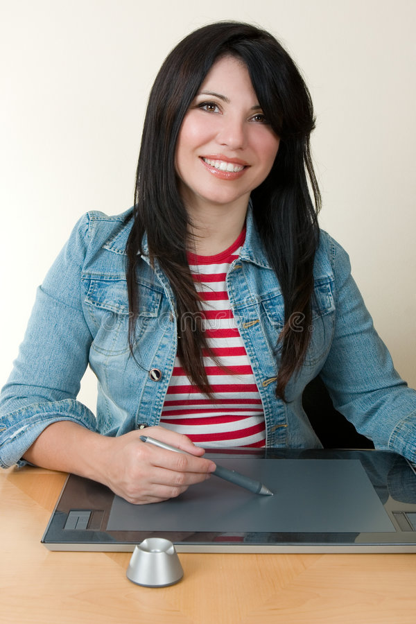 Download Woman Using A Graphic Tablet And Pen Stock Photo - Image: 2057964