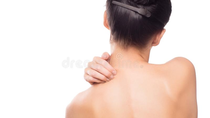 Woman using hand massage painful neck. And nape. red color highlight at neck , neck muscles isolated on white background royalty free stock photos