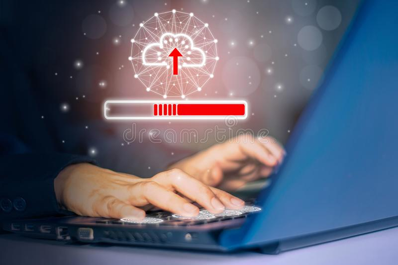 Woman using hand touch keyboard laptop computer,dark background with symbol cloud, Concept collect data cloud computing technology royalty free stock photo
