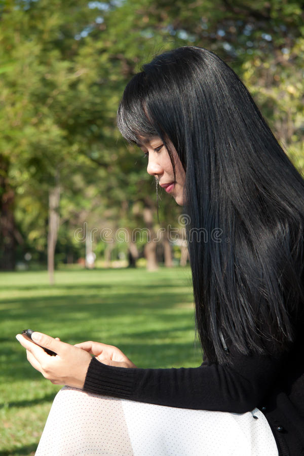 Woman Using Handheld. Stock Photos