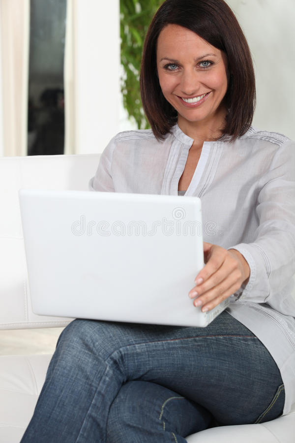 Download Woman using her laptop stock photo. Image of mail, communication - 33671482