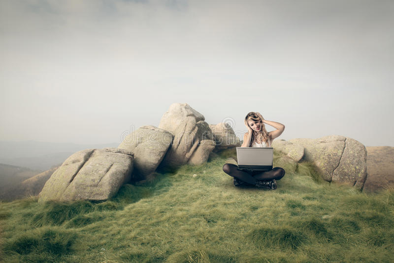 Download Woman using her laptop stock image. Image of greenfield - 39513893