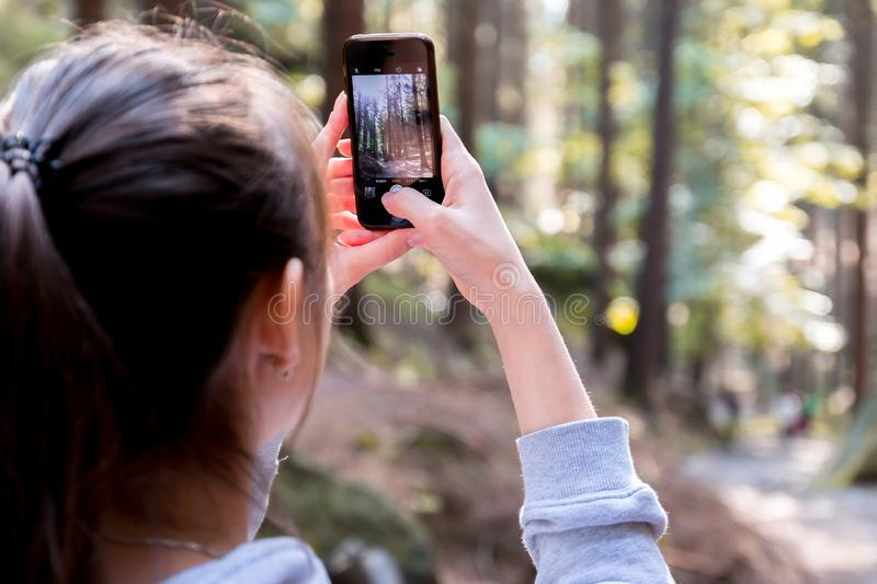 Woman Using Her Smartphone While Taking The Picture The Forest Free Public Domain Cc0 Image