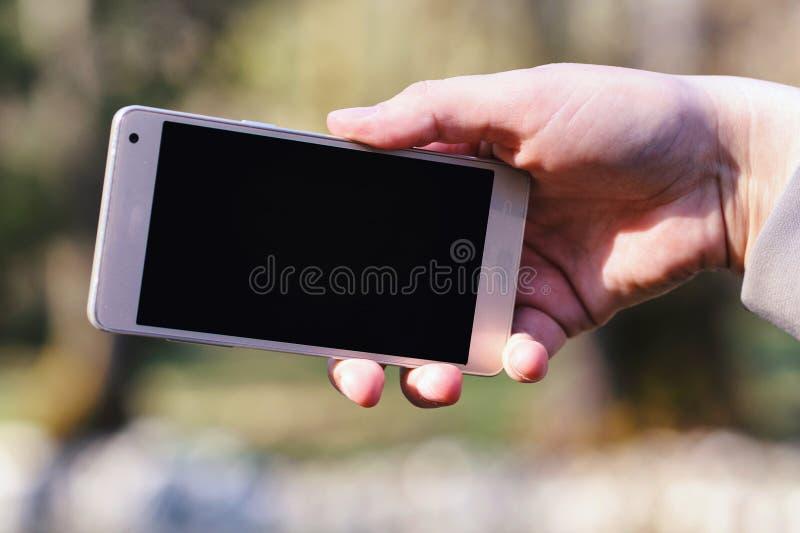 Woman using her smartphone stock photo