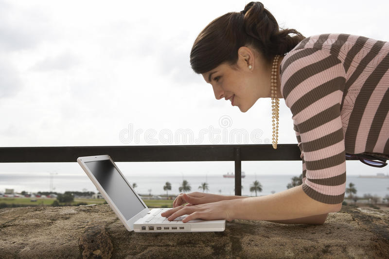 Download Woman Using Laptop Royalty Free Stock Photos - Image: 24876378