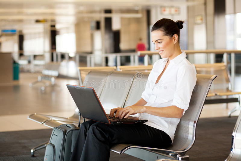 Download Woman Using Laptop At Airport Stock Image - Image: 23913275