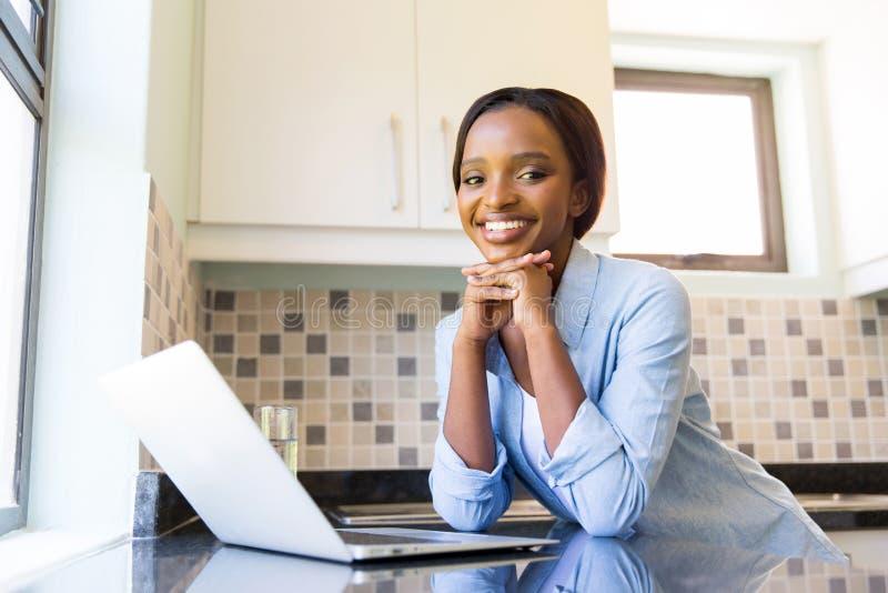 Woman using laptop stock photography