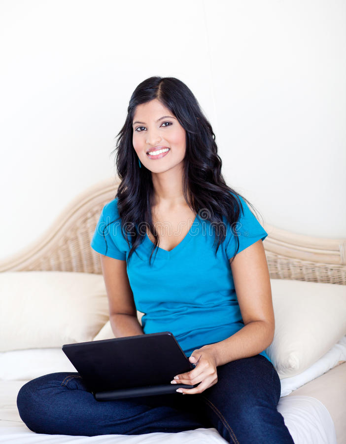 Download Woman using laptop on bed stock image. Image of casual - 23392001