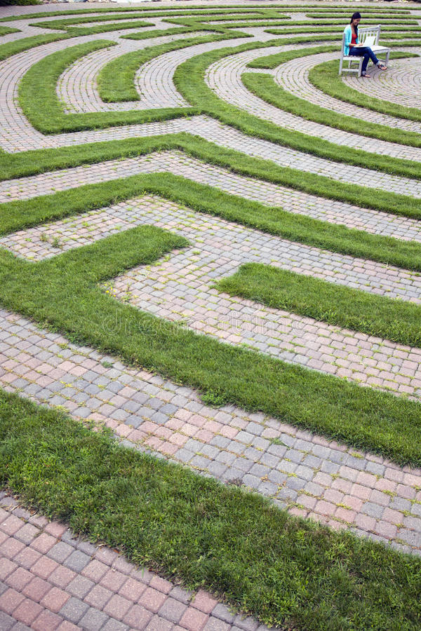 Download Woman Using Laptop In A Cobblestone Maze Stock Photo - Image of maze, path: 15673414