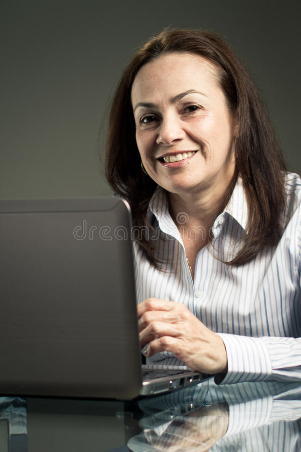 Woman Using Laptop Computer Stock Images