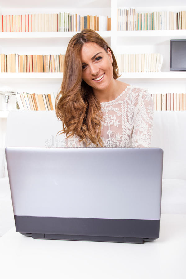 Download Woman Using A Laptop Computer At Home And Looking In Camera Stock Image - Image of cute, looking: 39501009