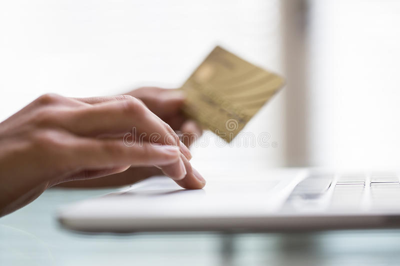 Download Woman Using Laptop And Credit Card.close-up Hands Stock Images - Image: 33078044