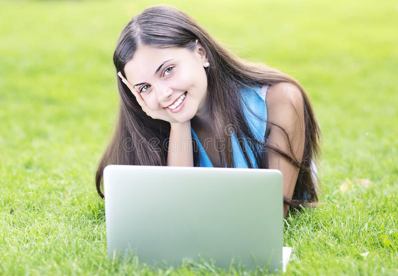 Download Woman Using A Laptop Outdoors Stock Image - Image: 34023439