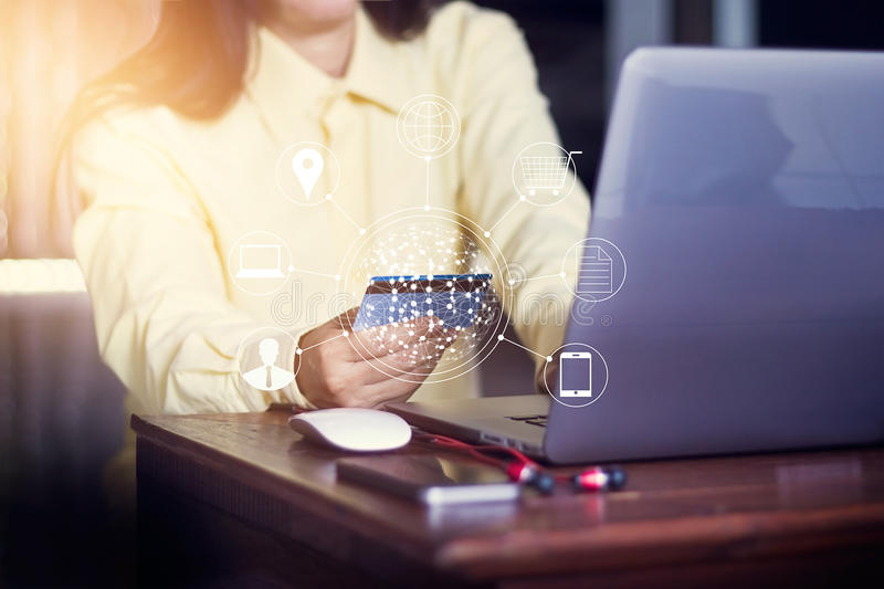Woman using laptop payments online shopping and icon customer network connection. M-banking and omni channel stock images