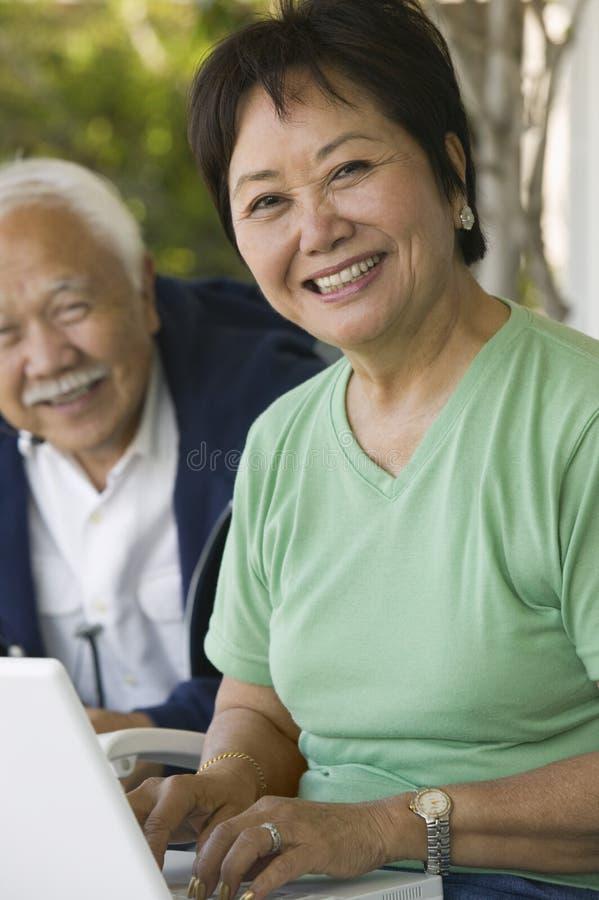 Woman Using Laptop (portrait) stock image