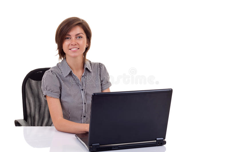 Woman Using Laptop At Work Desk Stock Photo