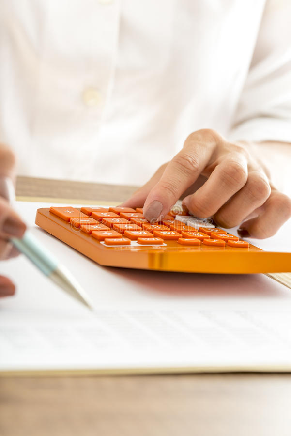 Woman using a manual calculator royalty free stock images