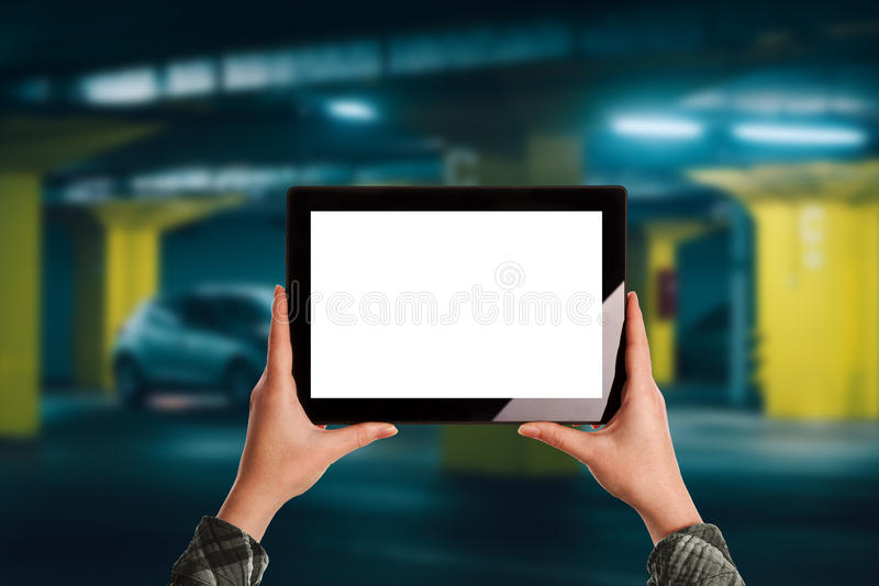 Woman using mobile application for car parking in underground ga stock photos