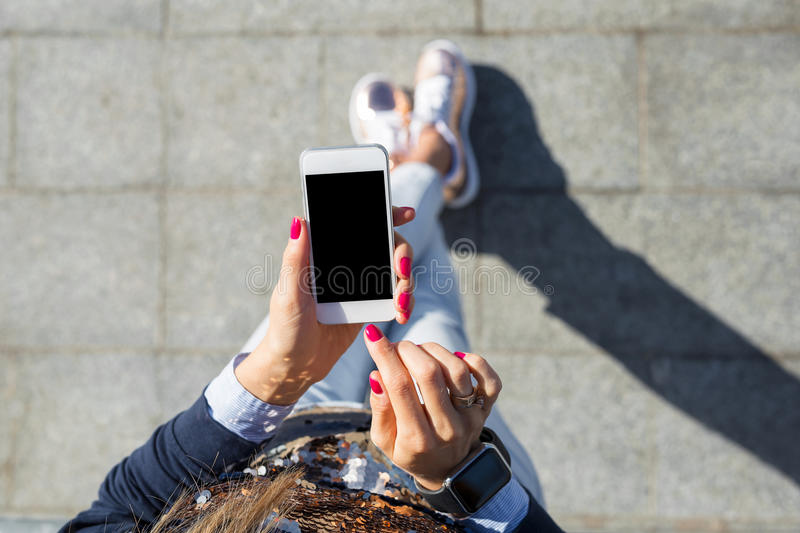 Woman using mobile phone. While being outdoors