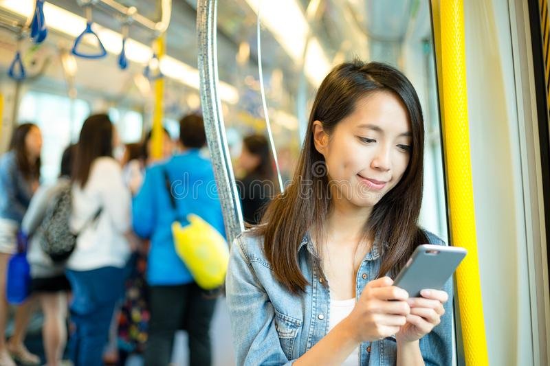 Woman using mobile phone inside train compartment royalty free stock photos