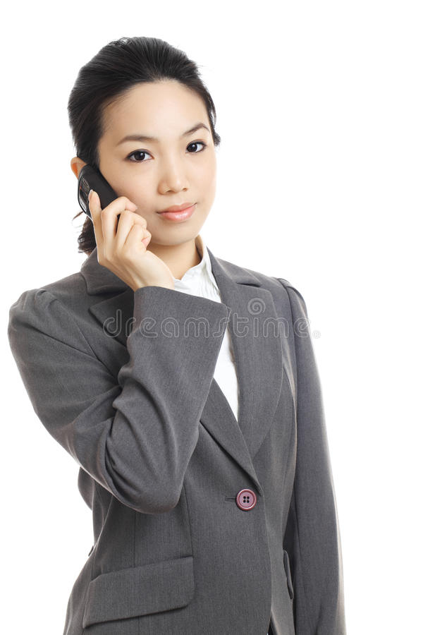 Woman using mobile phone. Isolated on white background royalty free stock photo